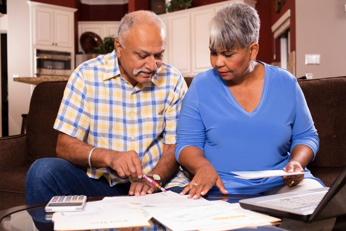 Photo of a senior couple looking at paperwork